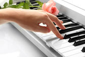 Hand of woman playing synthesizer   — Stock Photo