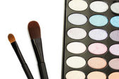 Shadow kit with brushes for make-up isolated on white — Stock Photo