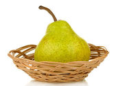 Ripe pear in wicker basket isolated on white — Stock Photo