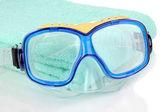 Swim goggles on towel isolated on white — Stock Photo
