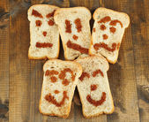 Funny toasts, on wooden background — Stock Photo