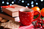 Composition of book with cup of coffee and Christmas decorations on table on dark background — Stock Photo