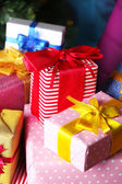 Christmas gift boxes on Christmas tree background — 图库照片