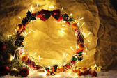 Beautiful Christmas wreath, on old paper background — Stock Photo