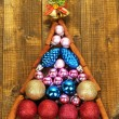 Christmas tree of Christmas toys on wooden table close-up — Stock Photo #46190395