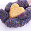 Female hands in mittens with heart on snow background — Stock Photo #46190401