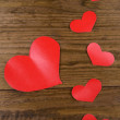 Paper hearts on wooden background — Stock Photo #46190445