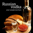 Bottle of vodka, red caviar, fresh bread on wooden board,  isolated on black — Stock Photo #46191801