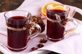 Mulled wine with cookies on table close up — Stock Photo