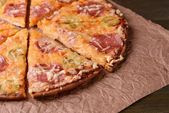 Tasty pizza on table close-up — Stock Photo