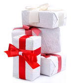 Beautiful gifts with red ribbons, isolated on white — Fotografia Stock