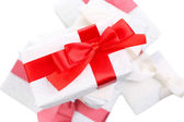Beautiful gifts with red ribbons, isolated on white — Stock Photo