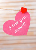 Happy Mothers Day message written on paper heart on light background — Stock Photo