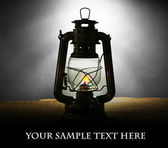 Kerosene lamp on dark grey background — Stock Photo