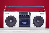 Retro cassette stereo recorder on table on red background — Foto Stock