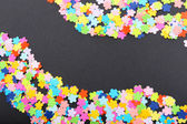 Confetti on black background — Stock Photo