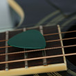 Colourful plectrum on guitar — Stock Photo #46302793