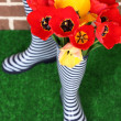 Composition of colorful tulips in rain boots on bright background — Stock Photo