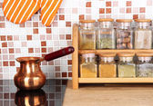 Pot on stove in kitchen — Stock Photo