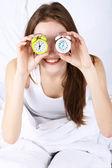 Woman with alarm clocks — Stok fotoğraf