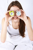 Woman with alarm clocks — Stock Photo