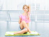 Young woman practicing yoga — Stock Photo