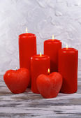 Beautiful candles on table on grey background — Stock Photo