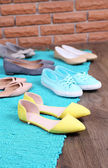 Female fashion shoes on blue carpet  — Stock Photo