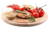 Grilled steak with spices, herbs and vegetables  on wooden board, isolated on white — Stock Photo