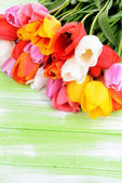 Beautiful tulips in bucket on table close-up — Stock Photo