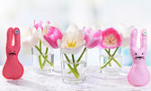 Beautiful tulips in bucket in vase on table on light background — Stock Photo