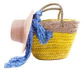 Wicker bag with hat and colorful scarf — Stock Photo