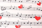 Paper hearts on music book — Stock Photo