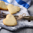 Lavender cookies on cutting board, on color napkin background — Stock Photo #46314597