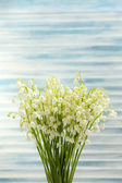 Beautiful lilies of the valley on wooden background — Zdjęcie stockowe