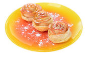 Tasty  puff pastry with apple shaped roses with powdered sugar isolated on white — Stock Photo