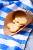 Lavender cookies in paper bag, on color napkin background — Stock Photo