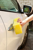 Outdoor car wash with yellow sponge — Stock Photo