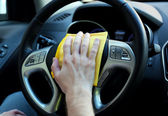 Hand with microfiber cloth polishing car — Stock Photo