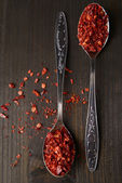 Spice pepper in spoons on wooden background — Fotografia Stock