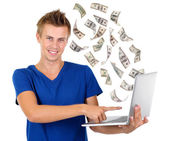 Dollars and laptop — Stock Photo