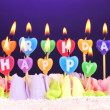 Birthday cake with candles on violet background — Stock Photo #46439831