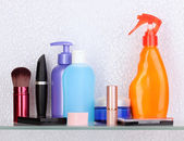 Shelf with cosmetics and toiletries in bathroom — Stock Photo