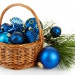 Christmas decorations in basket and pine branches isolated on white — Stock Photo