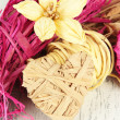 Decorative straw for hand made, flower and heart of straw, on wooden background — Stock Photo #46441347
