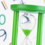 Hourglass on big clock background — Stock Photo #46446295