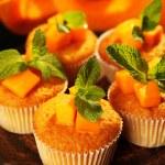 Tasty pumpkin muffins on dark background — Stock Photo #46446635