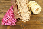 Decorative straw for hand made, on wooden background — Stock Photo
