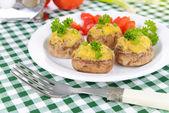Stuffed mushrooms on plate on table close-up — Stock Photo