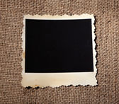 Blank old photo on sackcloth background — Stock fotografie